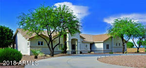Front of Home has great circular driveway & inviting entryway.