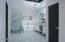 Luxurious spa style master bath with marble finishes.