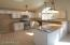 Kitchen with Granite counters and SS Appliances.