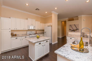Impressive Kitchen with Island Work Space and gas range