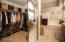 walk-in closet w/ mirrored closet doors