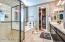 Large Master Ensuite with walk in closets with double sinks and ovdersized shower.
