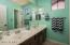 Hall bathroom with double sinks.