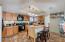 Bright open kitchen includes appliances.