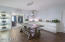 HUGE EAT IN KITCHEN DINING ROOM WITH STORAGE GALORE IS PERFECT FOR ENTERTAINING.