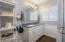 DOUBLE SINKS IN THE LIGHT AND BRIGHT MASTER BATHROOM