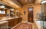 The well appointed master bath offers a soaking tub, walk-in shower, dual vanities and a spacious walk-in closet.