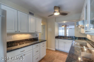 Lots of cabinetry, storage in this kitchen.