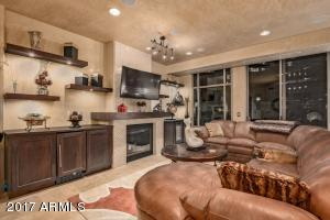"""Great room with fireplace and electronic shades in """"up"""" position"""