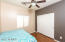 3rd bedroom with spacious double closet, laminate flooring, fresh paint, and ceiling fan!