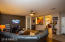 3rd view of spacious, open great-room, with breakfast bar off of the kitchen for easy, fun entertaining!