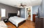 Master suite with laminate flooring, fresh paint, and ceiling fan! Plenty of beautiful natural light!