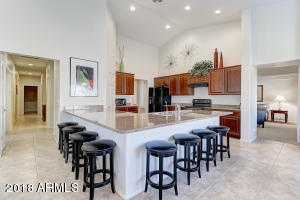 Large Open Concept Kitchen with peninsula island sitting for 8