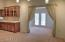 Looking into the enclosed porch behind the kitchen which is great for an activities room.