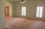 Living /dining room with it's high ceilings and shuttered windows.