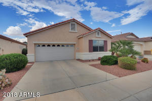 This lovely home is located on a N/S facing lot in the guard-gated 55+ community of Arizona Traditions.