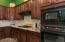 Kitchen with Gas Cooktop, Wall Oven & Microwave and Lots of Custom Cabinetry