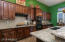 Kitchen with Slab Granite, Lots of Custom Cabinetry