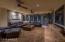 Custom A/V cabinetry; beautiful slump block & custom lighting adorn this great room
