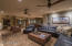 Great room, sitting area, dining, and entry illustrate open floor plan