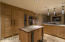 Ample custom cabinetry in this well-appointed kitchen