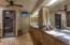 Floating cabinets, 'wading' pool sinks, metal-like tile enclosed shower