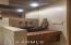 Powder Room has custom metal vessel sink and heavy custom wood base