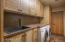 Plenty of cabinetry, a sink, and folding counter space