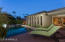 Evening pool/spa shot shows wall of windows at the great room & entry to dining from covered patio