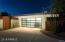 Custom glass & metal garage door; metal enclosures, detail walls & trellises about the property were custom made