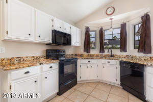 Updated white cabinets & gorgeous granite counters