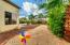 East side yard, space to dream big...Kids sand pit, horseshoes, garden area...anything