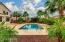 Beautifully designed backyard, with surrounding Palm trees