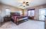 Very Spacious bedroom, door leading to covered patio.