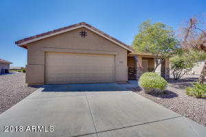 Perfect home nestled on a Golf Course lot in the desirable Adult Community of Sundance.