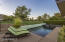 Views to the fairway at dusk...vines at the south end of yard provide privacy for pool & spa enjoyment...