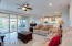 Great room with 5.1 surround sound and center multi-panel sliding glass doors open up to the covered patio.