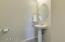 Wash room, half bath off hallway.