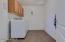 Roomy laundry room with extra storage!