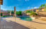 Large patio area surrounding the pool.