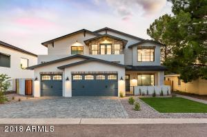 Welcome to this absolutely breathtaking 2018 new build brought to you by Barkan Construction Group, Coco&Co Design and The Glimcher Team. From the moment you pull into the driveway, you will be mesmerized by the incredible finishes throughout this charming Arcadia Lite home. Boasting 4 bedrooms plus office/den and large loft space, 3.5 bathrooms, 3 car garage and an amazing patio with unbelievable Camelback Mountain views. Located within walking distance of Arcadia's trendiest restaurants, bars and local favorite hot-spots. This home is simply a must-see and won't last long! Set up a showing today!