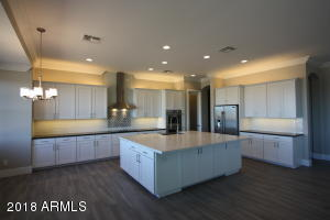 Amazing kitchen with plenty of cabinet space and huge island.