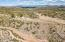 Arizona Privacy is calling your name: 750 W Bralliar Road, Towering Above the town of Wickenburg Arizona, 19 Acres of Mountain Top Privacy, 6 Bedrooms, 5 Baths PLUS a Guest House, Pool & Private Courtyard, Private Drive, Priceless Views.