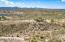 Minutes from the grocery store and hospital too...750 W Bralliar Road, Towering Above the town of Wickenburg Arizona, 19 Acres of Mountain Top Privacy, 6 Bedrooms, 5 Baths PLUS a Guest House, Pool & Private Courtyard, Private Drive, Priceless Views.