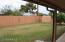 Yard has 6' brick fence