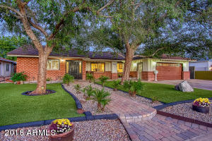 Lush Mature trees, synthetic grass and cobblestone walk & drive way
