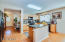 Kitchen boasts large island, dining area and walk in pantry.