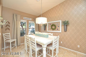 This gorgeous eat in breakfast/dining room is vaulted with lots of natural light from the front window!