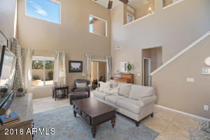 Giant two story vaults in family room makes family room feel ope, bright, and inviting.
