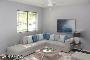 This home features a formal living room for special occasions. Soft natural ight into living room.